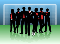 Negotiation Seminar team in business suits at soccer goal