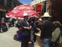 Coca-Cola umbrella stands in China and people negotiating