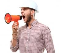construction man with bullhorn lying in negotiations