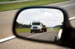 Rear view  mirror with truck in view like negotiator looking out for danger